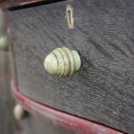 A close look at the green distressed knobs