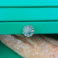 The glass knob pairs wonderfully with the emerald green