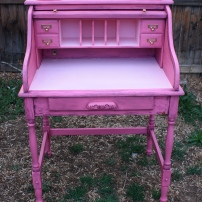 The work surface and cubbies are painted in a contrasting light, barbie pink