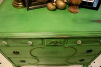 Glass knobs complement the green and the original hardware beautifully