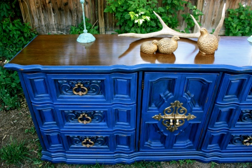 Deep royal blue, dark wax, medium walnut stain, and original brass hardware