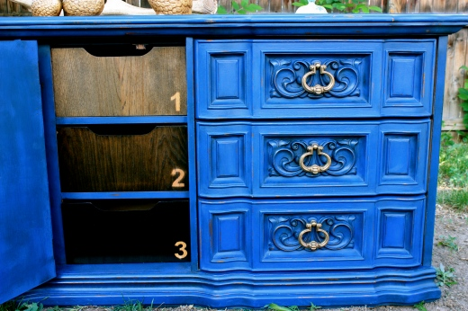 Fun ombre stained hidden drawers in the middle