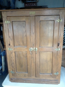 Ice-box reproduction.  Originally a TV armoire. Will soon be a beautiful bar cabinet!