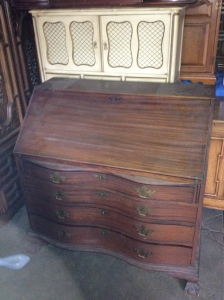 1930's Secretary desk with serpentine front, 4 drawers, and eagle's claw feet.  Beautiful!
