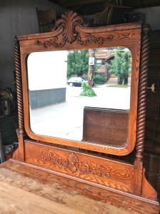 Don't normally find such detailed mirrors on utilitarian, farmhouse dressers.